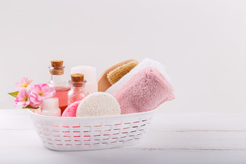 Pink Spa setting and health care items on white background. Space for text