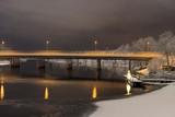 Night view of traffic crossing a concrete bridge  across a river