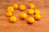 Tangerines scattered on the old rustic table