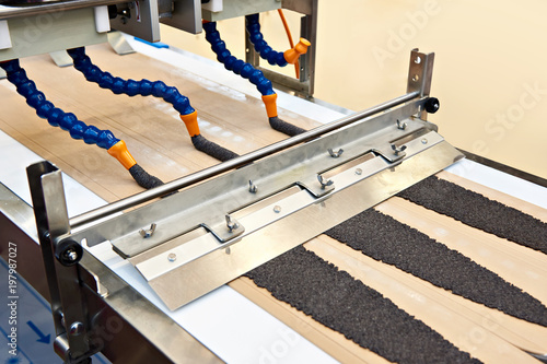 Machine with tubes for dough filling