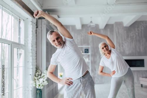 Leinwanddruck Bild Senior couple at home