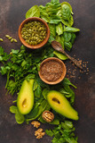 Green salad. Vegan ingredients: spinach, avocado, flax and pumpkin seed. Food background. Detox vegan healthy food concept. Top view, copy space. - 197995671