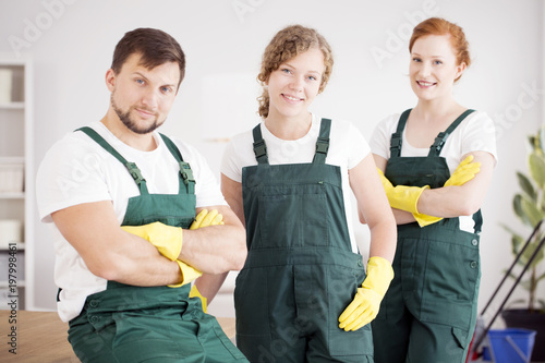 Two cleaning ladies and cleaner