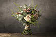 Bouquet of flowers on a wooden table - 198000069