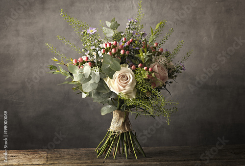Bouquet of flowers on a wooden table