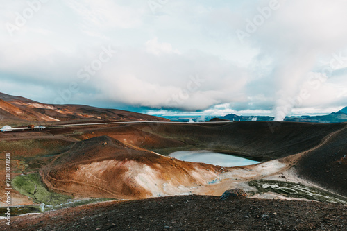 beautiful landscape with majestic volcanic lake and steam from hot springs, myvatn, iceland