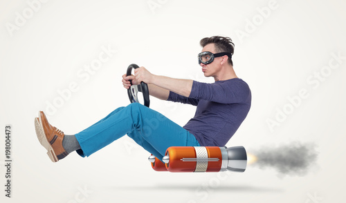 Funny man in goggles car driver with a wheel, concept of alternative transport