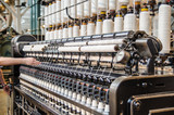 Operator hands on vintage automatic loom