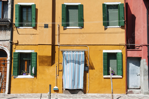 Fotobehang Venetie Burano island, Venice, Italy - a street with colorful houses