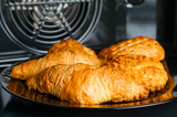 Fresh baked croissants in oven - 198025686
