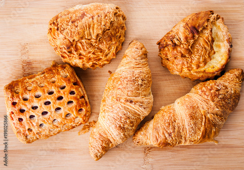 Fresh pastries close up on wooden background. Top view