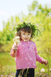 girl blowing dandelions in the air. selective focus.  - 198031680