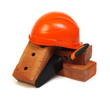 Brick, red hard hat and tools