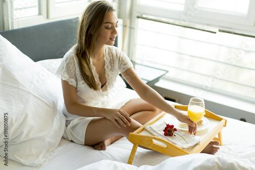Fotobehang Sap Breakfast in bed for young beautiful woman