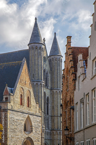 Foto op Canvas Brugge View of one street with old neogothical buildings in Bruges, Belgium