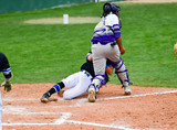 Baseball player safe after sliding into base