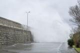 Stormy sea and chashing waves on breakwater, Varna, Black Sea, Bulgaria