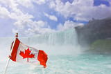 On Niagara River at the Horseshoe Falls with the Canadian Flag.