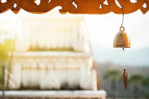 Fotobehang Boeddha buddha bell close up on background