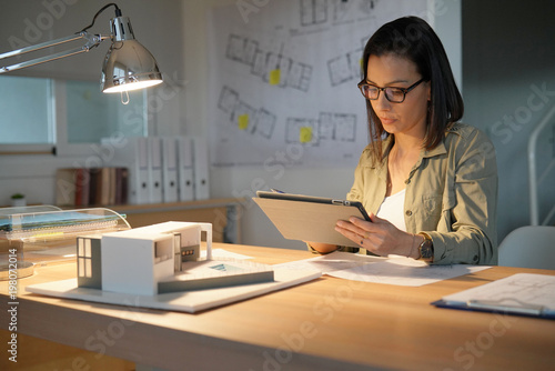 Fridge magnet Architect woman in office working on digital tablet