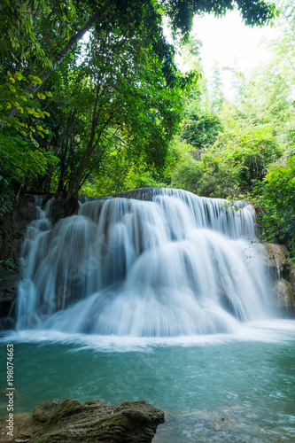 Huay Mae Khamin waterfalls in deep forest at Srinakarin National Park ,Kanchanaburi ,A beautiful stream water famous rainforest waterfall in Thailand - 198074663