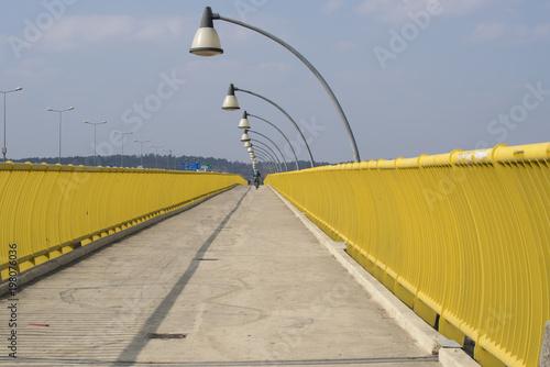 Fotobehang Krakau Yellow pedistrian crossing bridge over Vistula River in Krakow, Poland, Europe