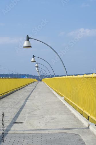 Foto op Plexiglas Krakau Yellow pedistrian crossing bridge over Vistula River in Krakow, Poland, Europe