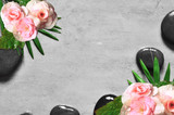 Set of pink rose flowers on pebble