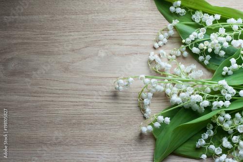 Fotobehang Lelietjes van dalen Lily of the valley on wooden table