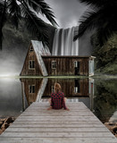 incredible scenary of a girl in front of a waterfall and a old house