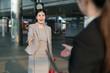 Businesswomen going to shake hands.