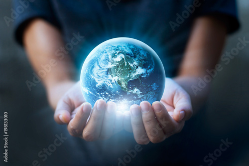 Foto Murales Earth day, Human hands holding blue earth, save earth concept. Elements of this image furnished by NASA