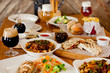 covered table with salad with soup with wine and beer with burger - 198139023