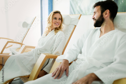 canvas print picture Handsome man and beautiful woman relaxing in spa
