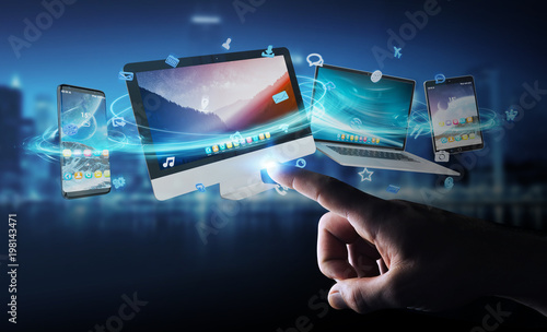 Businessman connecting tech devices and icons applications 3D rendering © sdecoret