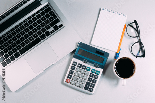 Top view Office desktop with office accessories, Desktop with business objects Hero header Concept. © cristalov