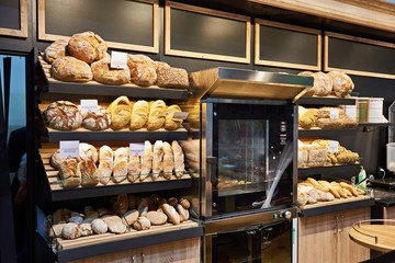 Fresh bread and pastries on shelves in bakery