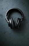 Black Headphones on dark stone background; seen from above - 198163274
