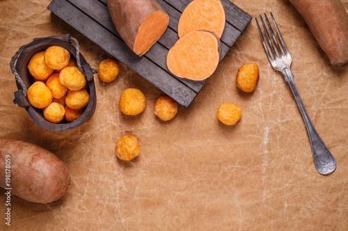 Fotobehang Bol Sweet potato croquettes