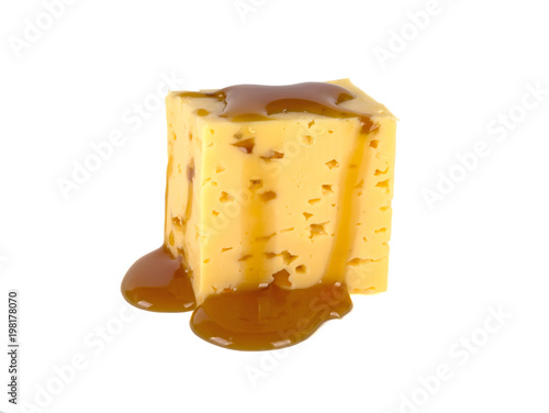 Poster Chicago caramel flowing on cheese cubes on a white background