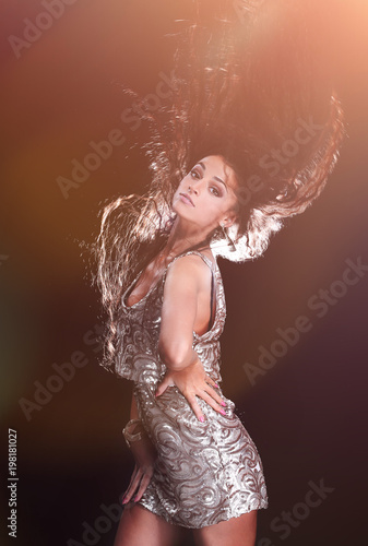 Portrait of a young girl dancing with long dark hair - 198181027