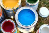 Tin cans with multicolored paint for working in the garden - 198194254
