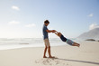 Father Having Fun With Son On Summer Beach Vacation - 198204213