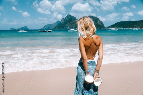 Girl relaxing on the tropical beach in Asia