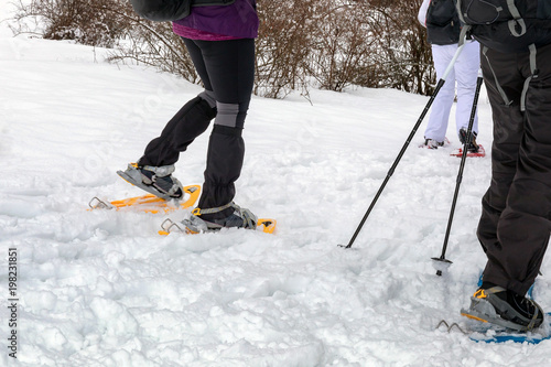 Snowshoe hike on the snowy mountain path. Walk on the fresh snow, using snowshoes.