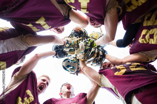 Plexiglas Voetbal American Football Team players huddle after their victory