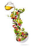 Flying vegetable greek salad isolated on white background.