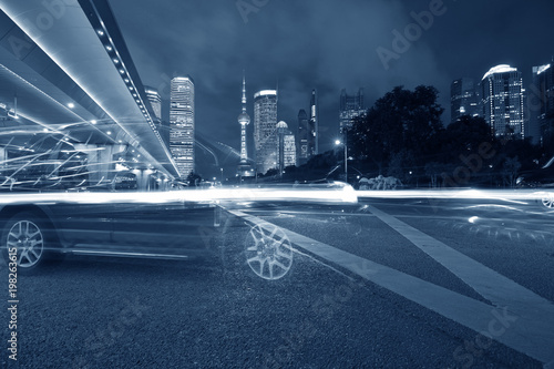 the light trails on the modern building background in shanghai china - 198263615