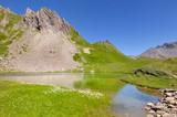 beautiful alpine  lake in mountain under blue