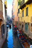 Venetian Gondolas in a side canal just off The Grand Canal, Venice